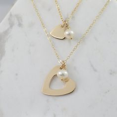 Mother daughter necklaces represent the love between a mother and daughters. Mother's necklace: The gold heart pendant with heart cutout is gold filled. It is about x Gold filled necklace is longFreshwater pearl is about Daughter's necklace: The heart ch Diamond Choker Necklace, Gold Bar Necklace, Necklace Set, Earrings, Mother Daughter Bracelets, Or Rose, Gold Heart, Daughters, Mom