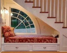 Fabulous window design compliments this under stairs reading nook.