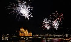 Fireworks burst over the Danube River near parliament in Budapest during a celebration markin