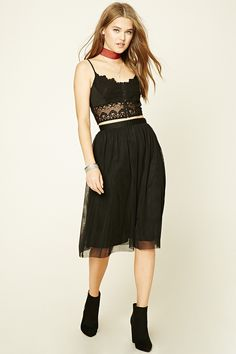 A tulle skirt featuring allover pleats, knit underlayer, an elasticized waist, and concealed side zipper with hook-eye closure.