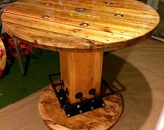 Repurposed Wire Spool Table  THE SPOOL IN PICTURE IS NOT THE ACTUAL SPOOL YOU WILL RECEIVE. I will send pictures of what i have in stock, in the size you are looking for. We basically pick your spool out together before i start working on it.  All of the spools i use are new or slightly used in the field. I do not use rotten or damaged spools. I purchase all of the spools i use directly from a supplier who hand picks each spool to ensure they are the highest quality possible. These are not…