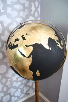DIY Black & Gold Globe. The black could be chalkboard paint! @Bailey Francine Francine Flores