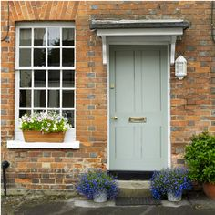 I just love the colour of the front door on this traditional cottage.