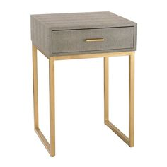 "How good looking is this single drawer side table? Hand covered in grey faux shagreen, we just can't get enough and think it would look great next to your sofa. Please note they are only 2 feet tall!   Dimensions: 16""W x 14""D x 24""H Materials: Faux Shagreen and Gold Metal"