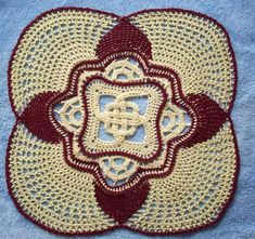This is basically the same design as the single color version of the Celtic Knot Doily except that this pattern has been written specifically for creating the doily in two colors. The pattern includes special stitches which enable the crocheter to work with two colors of thread at the same time. This doily is made using #10 crochet cotton and size #8 steel hook. The finished doily measures about 15 inches at its widest points.