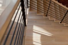 Pale white oak stair treads and flooring provide a neutral backdrop for this contemporary southwestern home.