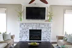 White-Washed Stone Fireplace. Love the idea of the Wood framing bump out behind the TV and the matching mantle with the stone fireplace.