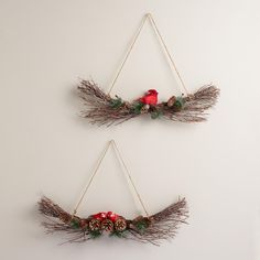 Deck your halls with our bird-adorned boughs, handcrafted of real twigs and pinecones and dusted with snowy glitter. These rustic hanging pieces make handsome perches for a bright cardinal and a pair of masked lovebirds.