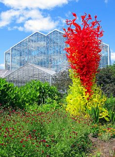 Citrus Green and Red Tower (1998)  Don Chihuly's Citrus Green and Red Tower (1998) in the Frederick Meijer Gardens and Sculpture Park of Grand Rapids stands in contrast to the park's conservatory.