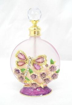 Perfect way to store your perfume! Rhinestone butterflies over purple glass, Glass Confusion on eBay!