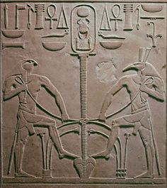"Horus and Seth pacified performing the Sema-Tawy Ritual (lotus and papyrus entwined, the Union of the Two Lands, Upper and Lower Egypt); on the top, above the Sema-Tawy symbol, is represented the Royal Cartouche with the name of King Sesostris I as ""King of Upper and Lower Egypt"", KheperKaRa; detail from the throne of a statue of King Sesostris I (1971-1926 bc)"