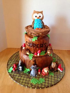 This cake is hand painted to resemble the look of wood. All animals handmade from fondant.