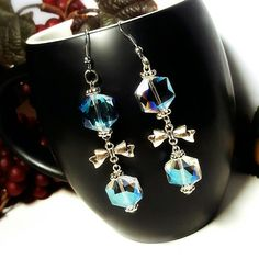 Only $6.99! - SALE Iridescent Ice Blue Glass Faceted Hexagon Dual Bead 3 Tier Drop Earrings w/Central Cute Silver Ribbon Bow Connector Charm FREE USA SHIPPING https://www.etsy.com/listing/278334224/sale-iridescent-ice-blue-glass-faceted #MothersDaySale #EtsyShop #EtsySale #MothersDayGifts #MothersDayJewelry #GiftsForHer #JewelryGiftIdeas #HexagonEarrings #BowCharmEarrings #SilverBowCharms #SpringtimeJewelry