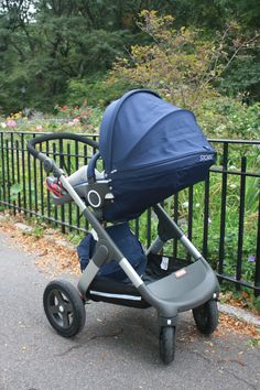 Stokke Trailz stroller in Deep Blue with matching Stokke Changing Bag accessory