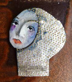 Handmade papier mache brooch her name is 'Shimmer'.