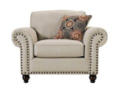 For a timeless living room with classic appeal, call on the Corliss chair-and-a-half. This piece will make a grand statement with its generously scaled seating and oversized nailhead trim adorning the ever-stylish rolled arms. The oatmeal-colored fabric is so versatile, and it's complemented beautifully by the bold accent pillow. Plus, its turned feet are finished in an attractive walnut tone that goes with everything.