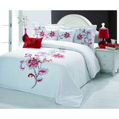 This high quality comforter set is crafted from plush cotton to provide soft luxury. This bedding is available in a beautiful red color and a embroidered floral pattern.
