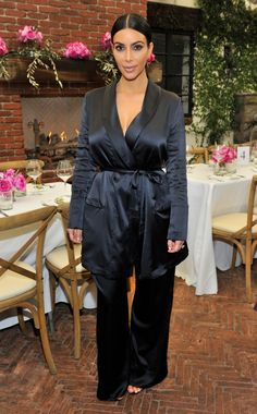 At a L.A. event.   I don't know about the top, it looks like a frumpy men's smoking robe. And the loose fitting pants look like pj pants. IT looks like she woke up and forgot to change her outfit....