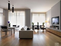 interiros shots of a modern living room in the foreground the leather sofa and the glass dining table the floor is made of wood living room interior royalty free stock images stock photo Home Living, Living Room Modern, Living Room Interior, Create Your House, Design Salon, Glass Dining Table, Home Renovation, Hardwood Floors, Parquet Flooring