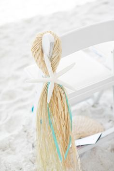 beach wedding aisle decor idea..raffia & starfish cute.