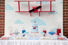 This airplane dessert table is amazing, especially the propeller! #airplane #birthday #desserttable #propeller