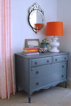 Orange lamp shade brings such a pop to this space