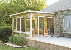 new ideas patio rooms design with sunroom plus beautiful lighting fixtures and brick wall also wood swing chair