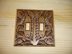 Designer hand carvings switch plate by creativemind44 on Etsy, $32.00