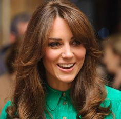 The Duchess of Cambridge is channeling 70's glam with this new layered hairstyle complete with long bangs.
