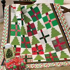 Pines & Presents: Cheerful Scrappy Christmas Lap Quilt Pattern Designed by DIANE DRAGOVICH MOORE Made by DIANE DRAGOVICH MOORE and the HUNTERDON COUNTY QUILTING GUILD, patterned in McCall's Quilting November/December 2013