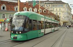 Tramway in city of Graz,Austria,Grazcity wallpaper free for your desktop background. Graz Austria, Strange Cars, City Wallpaper, Light Rail, Public Transport, Homeland, Places To See, Transportation, Around The Worlds