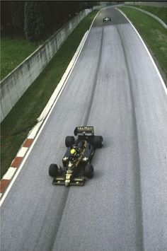 1986. San Marino Grand Prix.Imola. Ayrton Senna in his JPS Lotus-Renault 98T on the run down to Rivazza