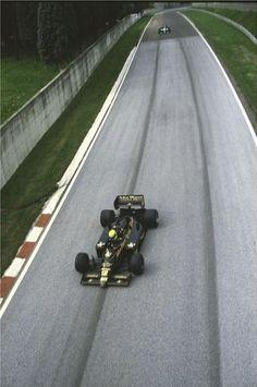 1986. San Marino Grand Prix.Imola. Ayrton Senna in his JPS Lotus-Renault 98T on the run down to Rivazza
