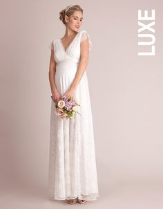 <b>Available from end of February</b> <ul> <li>Lace detailing to the shoulders</li> <li>V neckline and back</li> <li>Silk sash</li> </ul> <p>Add a touch of vintage glamour to your dream day with Seraphine's stunning maternity bridal gown in feminine French lace. Fully lined, the floral lace drapes dreamily over your curves to the floor in a beautiful full length a-line cut, offering a perfect fit for every stage of pregnancy. Feminine lace detailing with delicate eyelash trimmed edging to…