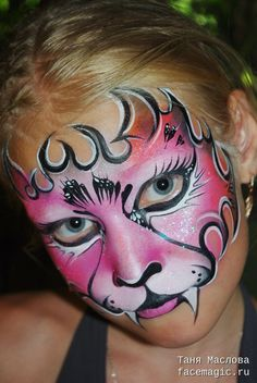 Face paint by Tanya Maslova. would make a great dragon face for a girl