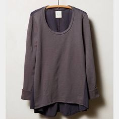 New Sam and Lavi Grey Mixmade Sweatshirt New, never worn, Sam and Lavi Mixmade Sweatshirt in grey size xs. Brand is available elsewhere, but purchased at Anthropologie. Front and sleeves are a sweatshirt material, while back is in a darker grey cotton. High-low hem. Anthropologie Tops Sweatshirts & Hoodies