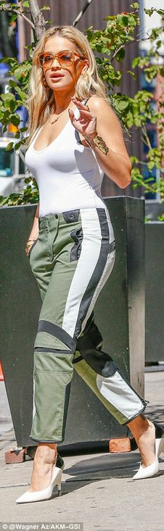 Stylish: The R.I.P singer teamed it with a stylish pair of khaki trousers with monochrome ...