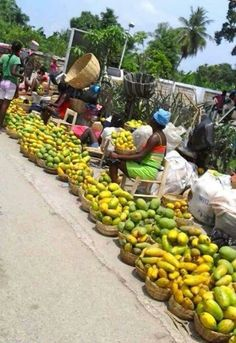A picture of a market in Haiti. All the fresh fruit look great, I would love to buy my fruits and vegetables there.