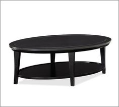 See PB look-alikes, this would be ugly. Metropolitan Oval Coffee Table, Black Pottery Barn $399