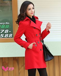Red trench coat. Also, she has nice hair and makeup.