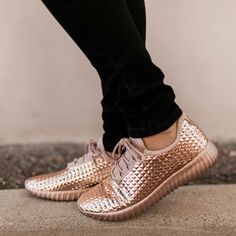 Rose Gold Sneakers  These super comfy sneakers are just what you need for everything from your daily commute to international travel! Lightweight metallic sneakers feature a textured surface that mimics pyramid-shaped studs and a tongue-less silhouette with an adjustable lace-up closure. Finished with a ridged sole.  Man made materials Made in China