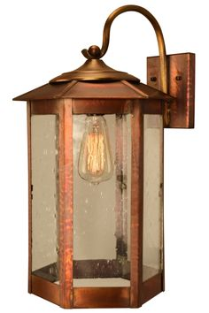 Baja Mission Style Outdoor Wall Light with Bracket Copper Lantern. This style outdoor lighting collection is authentically handmade with copper and brass.