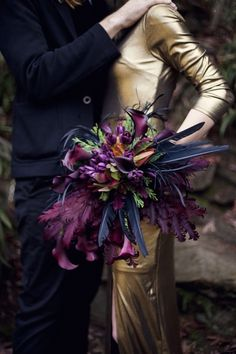 Eclectic feather and floral bouquet. Deep color palette.