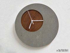 Each Clock is unique and the Concrete or Wood grain and color tone will vary slightly  More of my Concrete designs: