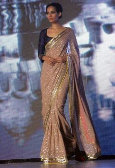 Manish malhotra - too much sequins but I like the nude with navy blouse