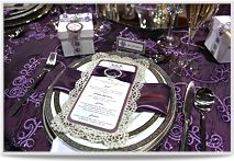 Vertical menu cards with on a silver die-cut lace background. Accented with eggplant purple satin ribbon and a rhinestone buckle. (Designed by Creative Weddings Stationary Designs; photo courtesy of Edward Ross Photography)