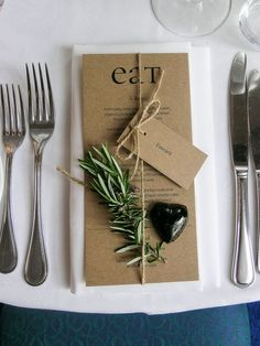 Craft paper menu with EAT graphic, rosemary and place and tied with twine - Carrie and Innes, married 17 October on a gorgeous Spring day - Mission Estate, HAWKES Bay.