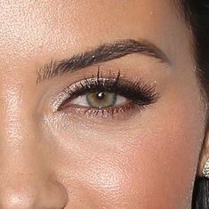 top is done in a light cool pinkish tone while her bottom lids are lined with a warmer bronzy mauve hue