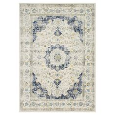 Anchor your dining set or den in timeless style with this lovely rug, showcasing a Persian-inspired motif in ivory and blue.  Produc...