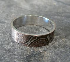 The ring is a size 10 and is 6mm wide. This Mokume Gane is constructed of 21 layers of sterling silver, copper and 5% shibuichi in a wave